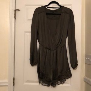 Silky dark green guess romper with lace detail